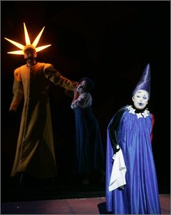 "Georg Zappenfeld in the role of Sarastro, Diana Damrau as Pamina and Sen Guo as the Queen of the Night, from left, perform during a dress rehearsal for Wolgang Amadeus Mozart's ""Magic Flute"" at Viienna's Theater an der Wien, on Wednesday, Aug. 7, 2008. Premiere is on Sunday, Aug. 10, 2008. (AP Photo/Stephan Trierenberg)"