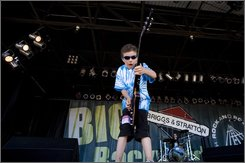 "Tallan ""T-Man"" Latz performs Monday, June 30, 2008, at Summerfest in Milwaukee. A blues guitar prodigy, the 8-year-old has played in bars and clubs, including the House of Blues in Chicago, and even jammed with Les Paul and Jackson Browne. However, the state of Wisconsin says that Tallan cannot play in taverns and nightclubs because of state child labor laws. (AP Photo/Morry Gash)"