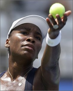 Venus Williams of the United States prepares to serve during her singles second round tennis match with Iveta Benesova of the Czech Repubic at the Beijing 2008 Olympics in Beijing, Tuesday, Aug. 12, 2008. Williams won 6-1, 6-4. (AP Photo/Charles Krupa)