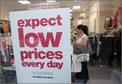 A shopper looks at clothing at a store at a mall in San Jose, Calif., Tuesday, Aug. 12, 2008. The government says retail sales fell in July, the weakest performance in five months. (AP Photo/Paul Sakuma)