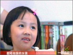 "This undated video frame grab image originally aired by China Central Television and taken from the Chinese website Sina.com, shows 7 year-old Yang Peiyi, the girl who actually sang during the opening ceremony of the Beijing 2008 Olympics. Lin Miaoke lip-synched the song ""Ode to the Motherland"" in a performance during the opening ceremony, while Yang Peiyi's voice was actually heard. (AP Photo/CCTV)"