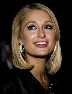 This Aug. 5, 2008  file photo shows Paris Hilton at the Tivoli amusement park  in Copenhagen, Denmark. (AP Photo/Tariq Mikkel Khan, POLFOTO, File)