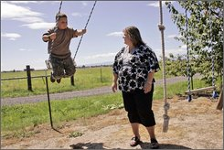 Colton Burkhart, 9, with his mother Kara Burkhart at his grandparents home near Terrebonne, Ore., Sunday Aug. 10, 2008. Colton and his family are cheering new legislation to ban lead in children's toys and take other steps to improve toy safety. (AP Photo/Rob Kerr)