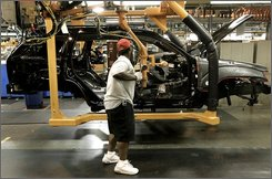 In this July 28, 2005 file photo, Dameon Hogan installs a dashboard into a Jeep Cherokee at the Jefferson North Assembly Plant in Detroit. Chrysler LLC Vice Chairman Tom LaSorda on Wednesday, Aug. 13, 2008 said his company will invest $1.8 billion to expand the plant and retool it to make a new car-based sport utility vehicle.  LaSorda said the factory should be retooled by the end of next year and will start cranking out the new vehicles early in 2010.  (AP Photo/Paul Sancya, file)