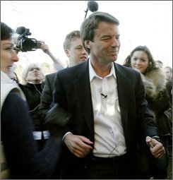 Rielle Hunter, left, holds a video camera as former North Carolina Sen. John Edwards campaigns in Portsmouth, N.H., Friday, Dec. 29, 2006. (AP Photo/Jim Cole)