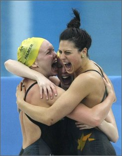 Australia's Kylie Palmer, Bronte Barratt and Stephanie Rice, from left, celebrate  setting a new world record and winning the gold in the women's 4x200-meter freestyle relay final during the swimming competitions in the National Aquatics Center at the Beijing 2008 Olympics in Beijing, Thursday, Aug. 14, 2008. (AP Photo/Anja Niedringhaus)
