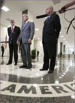 President Bush, flanked by CIA Director Michael Hayden, right, and Deputy CIA Director Stephen Kappes, makes a statement after participating in a briefings on terrorism and the Russian-Georgia conflict, Thursday, Aug. 14,2008, at CIA headquarters in Langley, Va.   (AP Photo/Gerald Herbert)