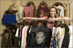Lyric Culture President Hanna Schmieder poses with her new line of clothing at the Lyric Culture showroom in West Hollywood, Calif., on Monday, June 2, 2008. (AP Photo/Damian Dovarganes)
