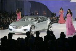 In this Jan. 12, 2008 file photo, the Chevrolet Volt concept is introduced at GM Style event in Detroit. Early versions of the Chevrolet Volt's battery packs are generating enough juice to run the high-stakes rechargeable car that General Motors hopes to start selling in 2010, but dozens of issues must be resolved before the revolutionary vehicle appears in showrooms. (AP Photo/Carlos Osorio, file)