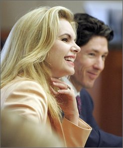 Victoria Osteen and her husband Joel Osteen wait in court during a break in testimony in her civil trial Friday, Aug. 8, 2008  in Houston.  Victoria, the co-pastor of Lakewood Church, is being sued by Continental flight attendant Sharon Brown who says Osteen assaulted her on a plane. (AP Photo/Pat Sullivan)