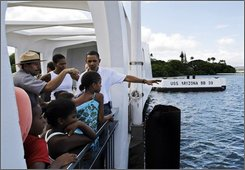 Democratic presidential candidate Sen. Barack Obama, D-Ill., right, talks as he tours the USS Arizona Memorial with family and friends in Pearl Harbor, Hawaii Thursday, Aug. 14, 2008. Sen. Obama is in Hawaii for a vacation.(AP Photo/Alex Brandon)