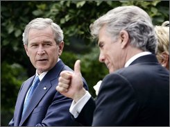 John Walsh gives a thumbs up as President Bush  looks on during a signing ceremony for the Adam Walsh Child Protection and Safety Act in the Rose Garden at the White House in this July 27, 2006 file photo. Nevada and other states are adopting laws that publicize the names of sex offenders on the Internet. But sex offenders say they have rights, too, and argue it's wrong to lump those guilty of minor offenses with the worst offenders. Some are challenging the laws. (AP Photo/Pablo Martinez Monsivais, file)