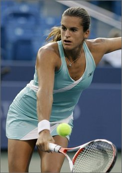 Amelie Mauresmo, from France, hits a volley against Yanina Wickmayer, from Belgium, during a match at the Western & Southern Financial Group Women's Open tennis tournament, Thursday, Aug. 14, 2008, in Mason, Ohio. (AP Photo/Al Behrman)