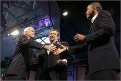 Republican presidential candidate, Sen. John McCain, R-Ariz., left, and Democratic presidential candidate Sen. Barack Obama, D-Ill., reach out to shake hands during the Compassion Forum at the Saddleback Church, Saturday, Aug. 16, 2008 in Lake Forest, Calif. Host Rick Warren is seen at center. (AP Photo/Mary Altaffer)