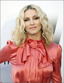In this May 22, 2008 photo, singer Madonna arrives for the 2008 amfAR Cinema Against AIDS benefit in Mougins, southern France. (AP Photo/Matt Sayles, file)