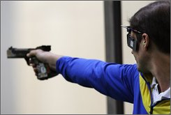 Ukraine's Oleksandr Petriv shoots in the final round of the men's 25-meter rapid fire pistol shooting event at the Beijing 2008 Olympics in Beijing, Saturday, Aug. 16, 2008. Petriv won the gold medal. (AP Photo/Sergey Ponomarev)