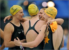 Australian team, from left, Leisel Jones, Emily Seebohm, Lisbeth Trickett and Jessicah Schipper react after winning the gold in the women's 4x100-meter medley relay final during the swimming competitions in the National Aquatics Center at the Beijing 2008 Olympics in Beijing, Sunday, Aug. 17, 2008. (AP Photo/Mark J. Terrill)
