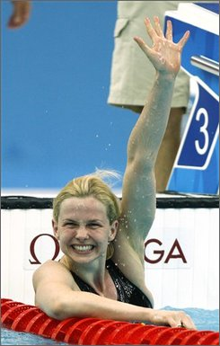 Germany's Britta Steffen celebrates after winning the gold in the women's 50-meter freestyle final during the swimming competitions in the National Aquatics Center at the Beijing 2008 Olympics in Beijing, Sunday, Aug. 17, 2008. (AP Photo/Mark Baker)