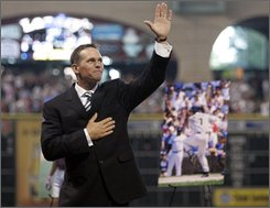 Former Houston Astros baseball player Craig Biggio acknowledges the fans at his number retirement ceremony before a baseball game between the Astros and the Arizona Diamondbacks Sunday, Aug. 17, 2008 in Houston. (AP Photo/Pat Sullivan)