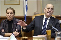 Israeli Prime Minister Ehud Olmert, right, speaks as Israel's Foreign Minister Tzipi Livni listens during a cabinet meeting in Jerusalem, Sunday, Aug. 17, 2008. Israel has approved the release of about 200 Palestinian prisoners as a goodwill gesture to the Palestinian government. Prime Minister Ehud Olmert's Cabinet overwhelmingly passed the proposal at a meeting Sunday. (AP Photo/ Jim Hollander, Pool)