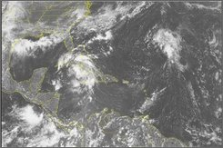 This NOAA satellite image taken Sunday, August 17, 2008 at 01:15 PM EDT shows  clouds near Cuba where Tropical Storm Fay continues on her trek towards the US.  The storm could gain hurricane status before making landfall over Florida. (AP PHOTO/WEATHER UNDERGROUND)
