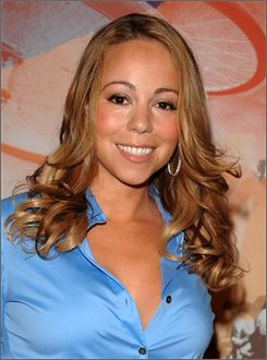 "In this July 22, 2008 file photo, singer Mariah Carey poses backstage at MTV Studio's in Times Square for MTV's ""Total Request Live"" show in New York. (AP Photo/Peter Kramer, file)"
