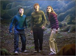 """In this image originally released by Warner Bros., Daniel Radcliff, portraying Harry Potter, left, Rupert Grint, portraying Ron Weasley, center, and Emma Watson as Hermione Granger are shown in a scene from the film, """"Harry Potter and the Order of the Phoenix"""".  Warner Bros. says it's bumping """"Harry Potter and the Half-Blood Prince"""" from its planned November release into next summer.  The sixth installment in the blockbuster franchise about boy wizard Harry now will open July 17 rather than Nov. 21, the studio said Thursday, Aug. 14.  (AP Photo/Warner Bros., Murray Close)"""