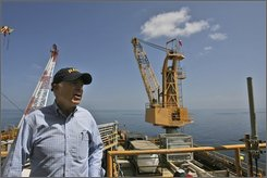 Republican presidential candidate, Sen. John McCain, R-Ariz., talks to reporters after touring the Chevron Genesis Oil Rig Platform in the Gulf of Mexico near New Orleans, La., Tuesday, Aug. 19, 2008.   (AP Photo/Mary Altaffer)