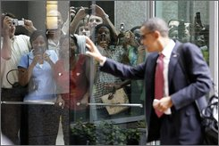 Democratic presidential candidate Sen. Barack Obama, D-Ill., waves to the crowd as he arrives at the hotel in Raleigh, N.C., Tuesday, Aug. 19, 2008.  (AP Photo/Alex Brandon)