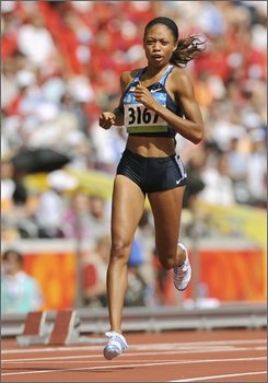 Allyson Felix of the United States competes in a heat of the women's 200-meter during the athletics competitions in the National Stadium at the Beijing 2008 Olympics in Beijing, Tuesday, Aug. 19, 2008. (AP Photo/Mark J. Terrill)