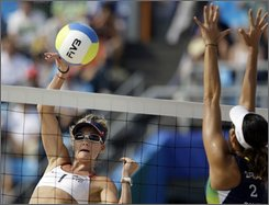 United States' Kerri Walsh (1) hits against Brazil's Talita Antunes in a semifinal beach volleyball match at the Chaoyang Park Beach Volleyball Ground at the Beijing 2008 Olympics in Beijing, Tuesday, Aug. 19, 2008. (AP Photo/Natacha Pisarenko)