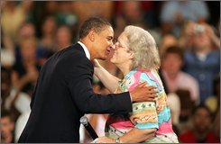 Democratic presidential candidate Sen. Barack Obama, D-Ill., hugs Gloria Craven of Eden, N.C. during a town hall meeting, Tuesday, Aug. 19, 2008, at North Carolina State Fairgrounds in Raleigh, N.C. (AP Photo/Jim R. Bounds)