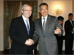 Australian Prime Minister Kevin Rudd, left, shakes hands with Singapore's Prime Minister Lee Hsien Loong at the Istana or Presidential Palace on Tuesday, Aug. 12, 2008 in Singapore. Rudd is in the city-state for an official visit where he met with the country's leaders and delivered a speech at the Singapore lecture. (AP Photo/ Wong Maye-E)