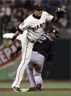 San Francisco Giants shortstop Emmanuel Burriss, left, collides with Florida Marlins' Hanley Ramirez (2) after throwing to first to complete a double play on Jeremy Hermida in the fourth inning of a baseball game Tuesday, Aug. 19, 2008, in San Francisco. (AP Photo/Ben Margot)