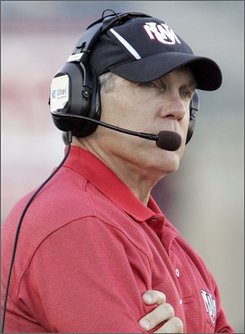 In this Oct. 28, 2006 file photo, New Mexico coach Rocky Long looks on during the second quarter of a football game against Colorado State in Fort Collins, Colo. The NCAA put New Mexico's football program on three years of probation Wednesday, Aug. 20, 2008 and cut five scholarships as punishment for academic violations involving two former assistant coaches. Long was not accused of any wrongdoing in the case. (AP Photo/Jack Dempsey, File)