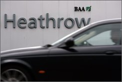 A motorist drives past a sign of airport operator BAA, seen on the entrance road to London's Heathrow airport, Wednesday Aug. 20, 2008. BAA, the owner of Heathrow, may have to sell three of its seven British airports, a British competition watchdog said Wednesday. The Competition Commission released a provisional report finding that BAA's dominant market position has resulted in a lack of airport capacity, slow development of new routes, higher charges for users and poor response to customers' requests. The commission is now in the process of deciding which two of London's three major airports  including Heathrow, Gatwick and Stansted  BAA should be required to sell, and which of either Glasgow or Edinburgh airports it should sell. (AP Photo/Lefteris Pitarakis)