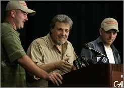 Hunter Tom Biscardi, center, gives a news conference with Rick Dyer, left, and Matthew Whitton, right, announcing that what they claim may be a deceased bigfoot or sasquatch in their possession Friday, Aug. 15, 2008, in Palo Alto, Calif. Whitton and Dyer say they stumbled across the corpse in the woods of northern Georgia, across the country from the remote regions of the Northwest where people usually claim to see the man-ape. Whitton, an officer on medical leave from the Clayton County Police Department, and Dyer, a former corrections officer, announced the discovery in early July. (AP Photo/Ben Margot)