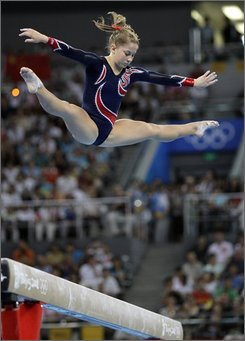 U.S. gymnast Shawn Johnson performs on the balance beam during the gymnastics apparatus finals at the Beijing 2008 Olympics  in Beijing, Tuesday, Aug. 19, 2008. Johnson won the gold medal. (AP Photo/Rob Carr)