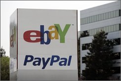 In this May 8, 2008 file photo, an Ebay/PalPal sign stands outside Ebay offices in San Jose, Callif. EBay plans to move nearly all transactions to electronic payment methods. Beginning in the U.S. in mid-October, users will have to pay by credit card, PayPal or the credit card processing service ProPay. No more cash, checks or money orders -- which account for less than 10 percent of eBay transactions these days -- unless sellers and buyers meet in person.  (AP Photo/Paul Sakuma, file)