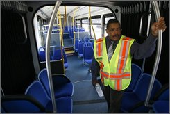 Bob Golden, Assistant Chief Engineer for Buses with Metro, stand inside a new bus in Washington on Monday July 21, 2008. Metro is rolling out brand-new buses with a modern red and silver color scheme, cushioned seats and sound-deadening floors for a quieter ride. (AP Photo/Jacquelyn Martin)