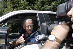Sen. Joe Biden, D-Del.,  drives up to his home past the news media Wednesday, Aug. 20, 2008 in Greenville, Del. Biden, Indiana Sen. Evan Bayh and Virginia Gov. Tim Kaine are believed to be on Democratic presidential candidate Barack Obama's short list. (AP Photo/Bradley C. Bower)
