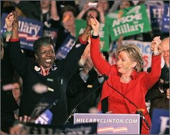 In this March 4, 2008 file photo, U.S. Rep. Stephanie Tubbs Jones, D-Ohio, left, joins Democratic presidential hopeful Sen. Hillary Rodham Clinton, D-N.Y., during a primary night rally in Columbus, Ohio. Tubbs Jones, 58, suffered a brain hemorrhage and was in critical condition with limited brain function, a doctor in Cleveland said Wednesday, Aug. 20, 2008. (AP Photo/Mark Duncan, File)