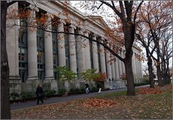 Students walk through the Harvard Law School area on the campus of Harvard University in Cambridge, Mass., in this Nov. 19, 2002 file photo. Harvard is back on top of the U.S. News & World Report college rankings, claiming sole possession of the No. 1 spot for the first time in 12 years. (AP Photo/Chitose Suzuki, file)