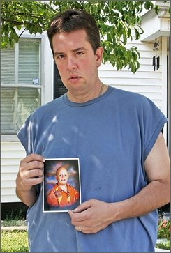 Roger McDonald, holds an undated photograph of his nephew Ryan McDonald after the 15 year old was fatally shot by another student at Central High School in Knoxville, Tenn., Thursday, Aug. 21, 2008. (AP Photo/Lisa Norman-Hudson)