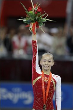 China's gymnast Yang Yilin stands with her bronze medal after the womens' gymnastics individual all-around competition at the Beijing 2008 Olympics  in Beijing, Friday, Aug  15, 2008. (AP Photo/Amy Sancetta)