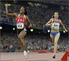 United States' Sanya Richards, left, celebrates winning the women's 4x400-meter final during the athletics competitions in the National Stadium at the Beijing 2008 Olympics in Beijing, Saturday, Aug. 23, 2008. At right is Russia's  Anastasia Kapachinskaya. (AP Photo/David J. Phillip)