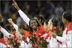 Delisha Milton-Jones and the rest of USA receives their gold medals after defeating Australia in the women's finall basketball game at the Beijing 2008 Olympics in Beijing, Saturday, Aug. 23, 2008.  (AP Photo/Eric Gay)