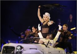Madonna performs on stage at the premier of her 'Sticky and Sweet' tour at Cardiff's Millennium Stadium in Wales, Saturday, Aug. 23, 2008. The queen of pop has kicked off her world tour, armed with three racks of clothing, a small mountain of diamonds, and a retinue large enough to fill a passenger jet. (AP Photo/Joel Ryan)