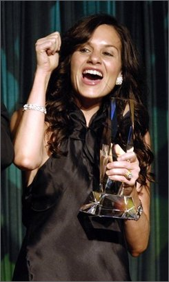 "Kara DioGuardi celebrates being named Co-Songwriter of the Year during the 55th Annual BMI Pop Awards in Beverly Hills, Calif., in a Tuesday, May 15, 2007 photo. Grammy-nominated songwriter DioGuardi has joined ""American Idol"" as a fourth judge and will sit alongside Paula Abdul, Simon Cowell and Randy Jackson at the judges? table. The eighth season of ""American Idol""  premieres in January, 2009, on FOX. (AP Photo/Chris Pizzello, File)"