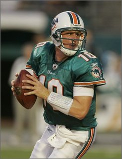 Miami Dolphins quarterback Chad Pennington drops back to pass during the first quarter of a preseason football game against the Kansas City Chiefs Saturday, Aug. 23, 2008 at Dolphin Stadium in Miami.  (AP Photo/Alan Diaz)